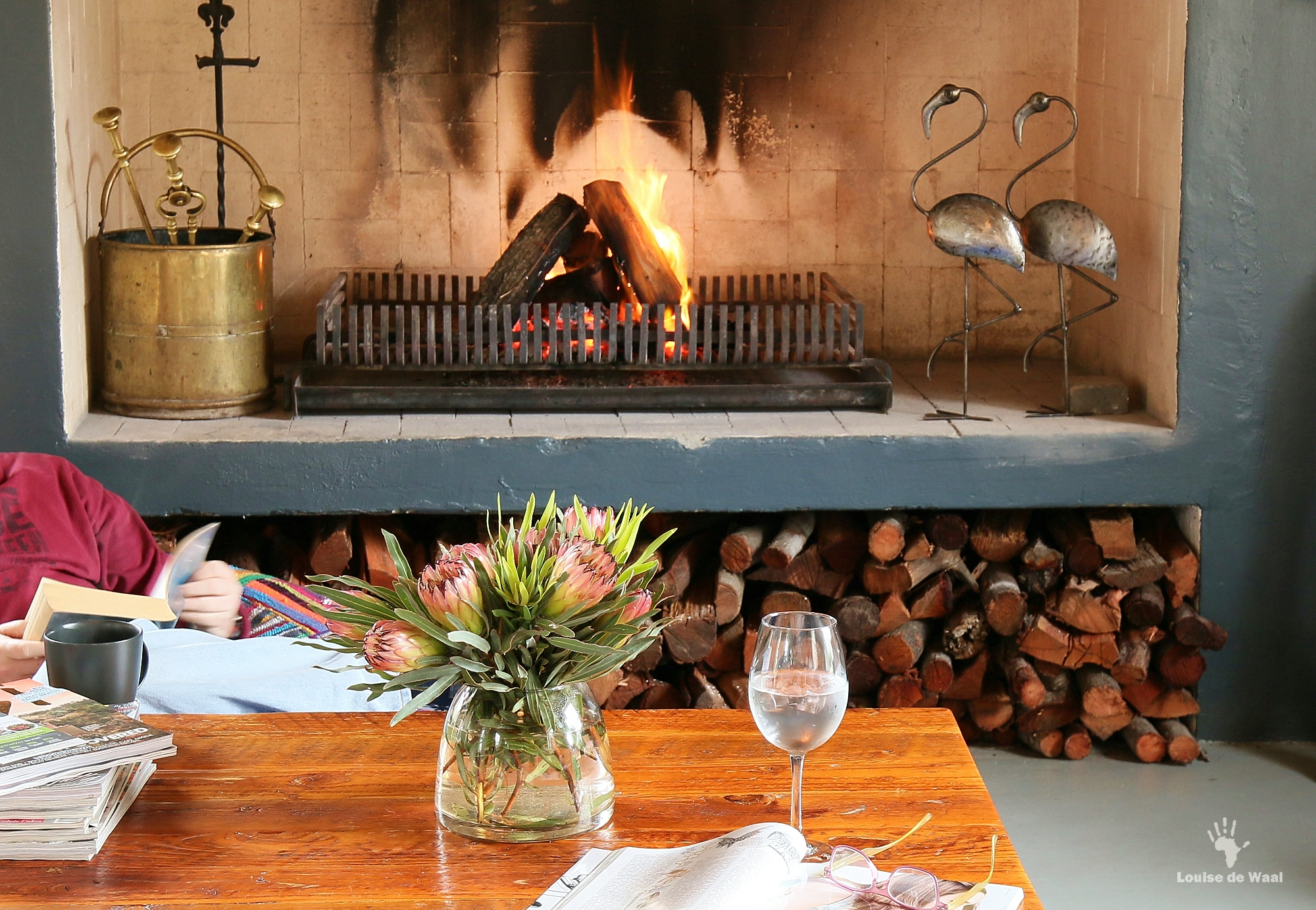 Reading by the fire at India House, Bastiaanskloof Reserve